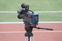 Video reportage. Video camera - broadcast of football match Royalty Free Stock Photography