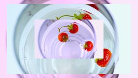 Video screensaver from strawberries,flashing wallpapers,fruits in water, graphics from fruits.Close-up.Colorful video theme
