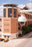 Video Security Camera Housings Mounted High on College Campus Royalty Free Stock Photography