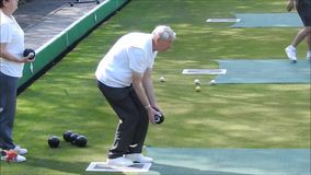Senior lawn bowling practise active outdoor hobby fitness health games stock footage