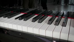 Detail of a piano playing alone stock footage
