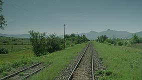 A video shot of a trainride. A video shot of a on board trainride stock video footage