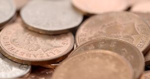 A shot of rotating British coins. Video of a shot of rotating British coins stock footage