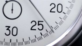 Video showing close-up Stopwatch. Clock on a dark background stock footage