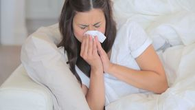 Video of sick woman sneezing stock footage