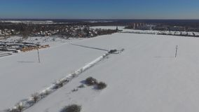 Video of the snow-covered field. Near a small village stock footage