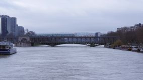 Static wide shot of a train passing over Pont de Bir-Hakeim during the Paris floods. Video of Static wide shot of a train passing over Pont de Bir-Hakeim during stock video
