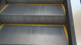 Video of steps rising up the escalator. The Video of steps rising up the escalator stock footage