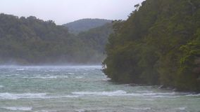 Strong wind blowing across a lake. Video of strong wind blowing across a lake stock footage