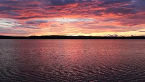 Sunset shot over water. Video of sunset shot over water stock video footage