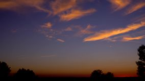 Sunset time lapse clouds mood sky. Video of sunset time lapse clouds mood sky stock video footage