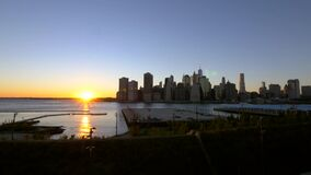Sunsetting over the Manhattan skyline. Video of sunsetting over the Manhattan skyline stock footage