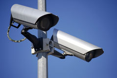 Video surveillance. Two video surveillance cameras against a blue sky royalty free stock photos