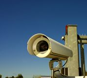 Video surveillance. Security Video surveillance camera against the blue sky Stock Photography