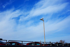 Video surveillance camera. On car parking Royalty Free Stock Photos