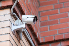 Video surveillance camera on brick wall Stock Photo