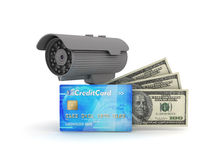 Video surveillance camera, credit card and dollar bills royalty free stock photo