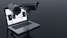 Video surveillance camera and laptop Royalty Free Stock Photography