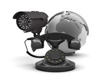 Video surveillance camera and retro rotary phone Royalty Free Stock Photo