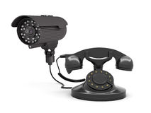 Video surveillance camera and rotary phone Royalty Free Stock Image