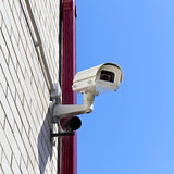 Video surveillance camera on a wall of the building Royalty Free Stock Image