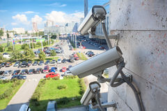 Video surveillance cameras on city wall Stock Photos
