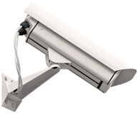 Video surveillance cctv camera, grey isolated large closeup, light grey gray Royalty Free Stock Images
