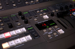 Video Switcher. An electronic video switcher in a digital editing suite Stock Image