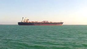 Tanker at anchor in the coastal waters stock video