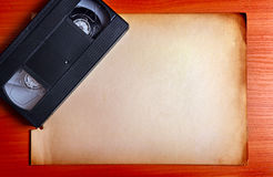 Video Tape on the Board. Retro Video Tape on the Board with the Empty Paper Royalty Free Stock Photos