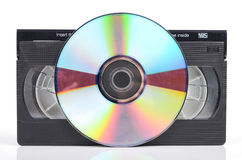 Video tape and DVD. On white background royalty free stock photo