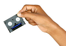 Video tape with hand. Video tape and  hand with clipping path Stock Images