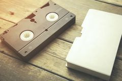 Video tape on table. Old retro video tape on wooden background stock photos