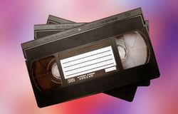 Video tapes. Against colorful background Royalty Free Stock Images