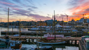 Video time lapse view of yachts in Oslo Harbor, Oslo Fjord at night in Oslo city, Norway, timelapse 4K stock footage