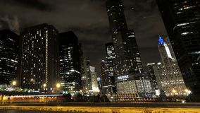 Chicago Skyscrapers at Night with Traffic Crossing the City Hyperlapse. Video timelapse of Chicago downtown skyscrapers with cars driving at full speed on its stock video footage