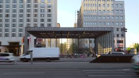Traffic passing the entrance of Potsdamer Platz train station. Video of traffic passing the entrance of Potsdamer Platz train station stock video footage