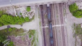 Video train with cars passing under the bridge with the road. Video from the drone. Video train with cars passing under the bridge with the road. Video from the stock video footage