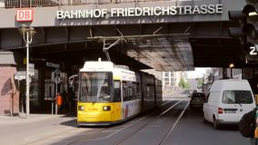 Tram passing under a bridge in central Berlin. Video of tram passing under a bridge in central Berlin stock footage