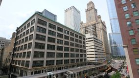 Two trains passing in downtown Chicago. Video of two trains passing in downtown Chicago stock footage