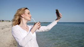 Video from vacation at sea, beautiful female on beach, sexy girl. Selfphoto on beach, girls photographed on android Shoot selfies, coconut in hands of young stock video