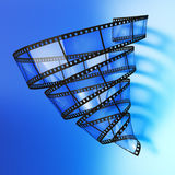 Video vortex. Film in the form of a vortex on blue background. Hi-res digitally generated image Royalty Free Stock Images