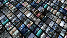 Video wall, diagonally. A diagonally image screen which shows a lot 3D clips. The entertainment wall is rolling down slantwise Stock Photo