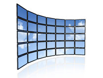 Video wall of flat tv screens. 3D video wall of flat tv screens with sky background, isolated on white. With 2 clipping paths : global scene clipping path and Royalty Free Stock Photo