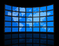 Video wall of flat tv screens with world map. 3D video wall of flat tv screens with world map, isolated on black. With 2 clipping paths : global scene clipping Stock Photo