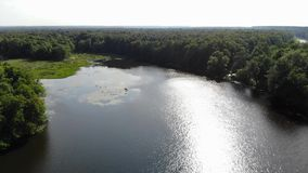 Video of a wide river from the air. The bend of the river.