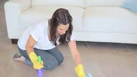 Video of woman scrubbing the living room floor stock video footage
