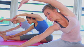 Video of women stretching on the floor Royalty Free Stock Photo