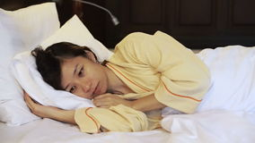 Video worried asian woman in bed, insomnia and thinking about life. Video of worried asian woman in bed, insomnia thinking about life stock footage