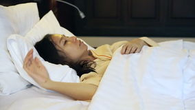 Video worried asian woman in bed, insomnia and thinking about life. Worried asian woman in bed, insomnia and thinking about life stock video footage